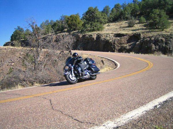 Motorcycle leaning on Coronado Trail, Arizona