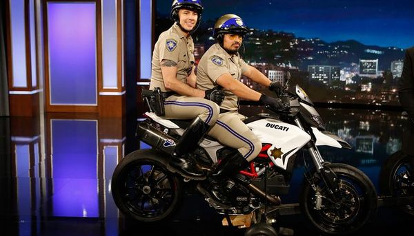 Chip stars Dax Shepard and Michael Pena posing on the HyperMotard