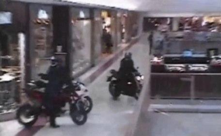 Axe wielding bikers storm shopping centre-Telegraph1