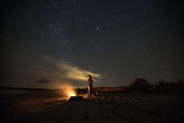James T under a starry Michigan sky by Spencer Millsap for EatSleepRIDE