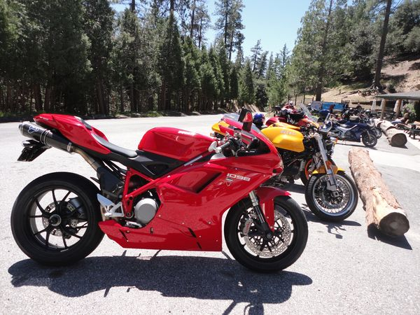 Ducati 1098 and other motorcycles in lot at Newcomb's Ranch