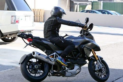 Orlando Bloom riding on his Ducati