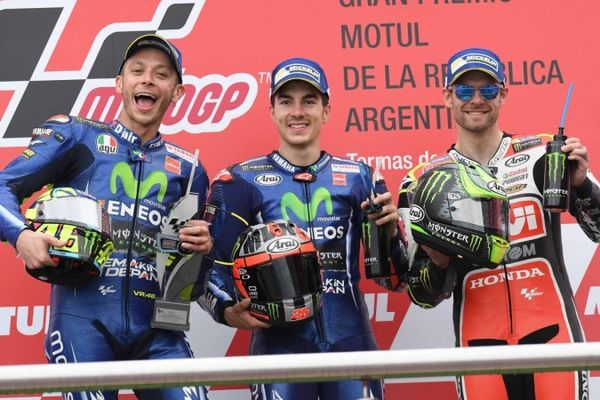 A happy (left to right) Rossi, Vinales and Crutchlow celebrating on the podium of the 2017 Argentina Grand Prix