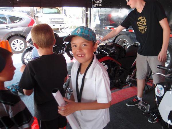 Boy get's Sean Smith's autograph - Honda CBR250R racer