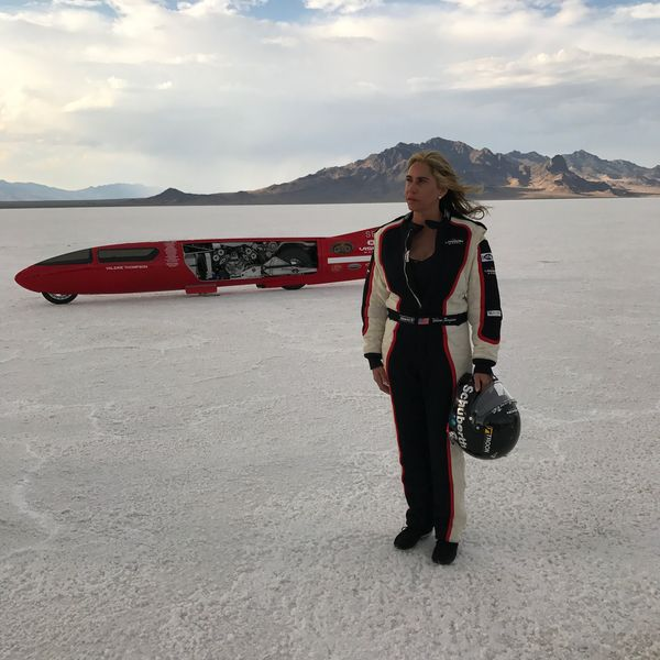 Valerie and her streamliner at the Salt Flats.