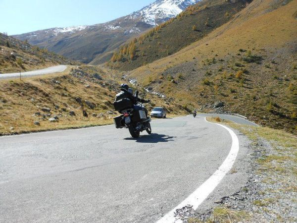 Motorcyclist enjoying the Umbrail Pass' curves