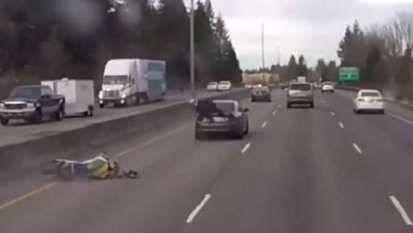 Video: Rider Plows into Car, Lands on Car, Hangs on