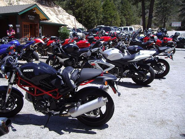 Ducati Monster, GSX-R and other motorcycles in lot at Newcomb's Ranch